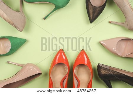 Picture of different leather shoes on light blue background. Copy space for text.