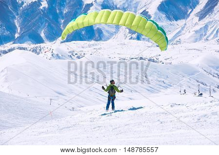 Fly in mountains by paraglider. Free happy life in mountains. Travel extreme concept.