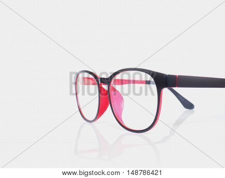 Black and red eye glasses on white background