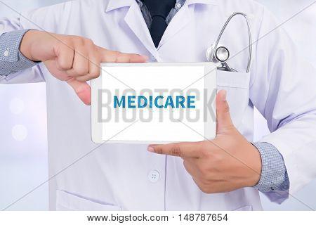 MEDICARE Doctor holding digital tablet doctor work touch