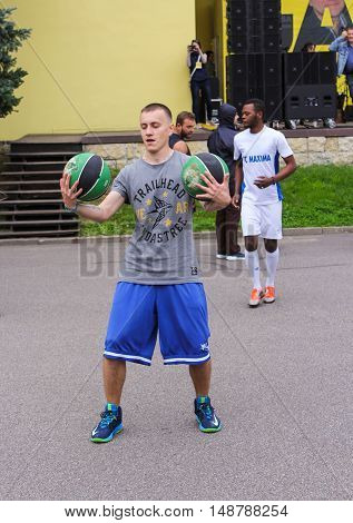 St. Petersburg, Russia - 13 August, Young man with two balls,13 August, 2016. Performance of the ball virtuosos on Krestovsky Island in St. Petersburg.