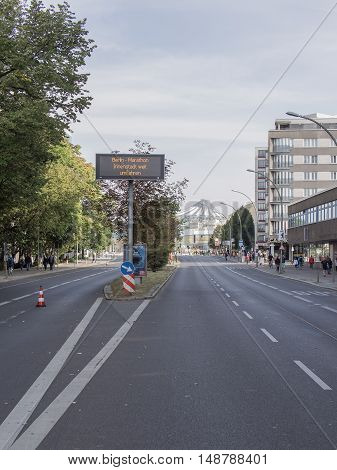 BERLIN GERMANY - SEPTEMBER 25 2016: Empty Street At Berlin Marathon 2016 Dome Of Potsdamer Platz In Background