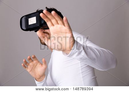 Young man experiencing virtual reality through a VR headset