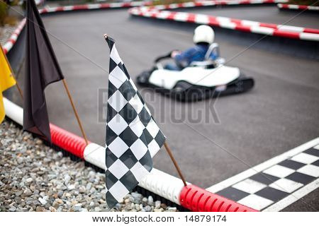 car and flags on karting track