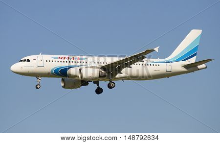 SAINT PETERSBURG, RUSSIA - AUGUST 21, 2015: Airbus A320-214 (VP-BHZ) of the company Yamal Airlines before landing in Pulkovo airport