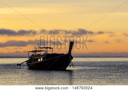 Boats wait for the tourists departing on the sunrise in the morning at railay krabi Thailand.