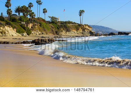 Beach Laguna Beach California USA. Waves in the Pacific Ocean at Victoria Beach in Laguna Beach California