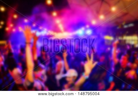 blur hand up in party.Colors full party