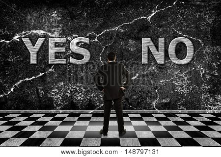 businessman trying to choose between a yes or no option
