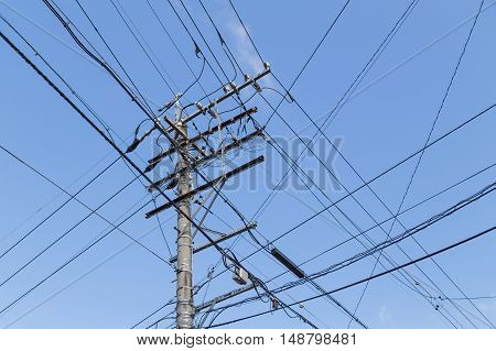 Electricity Pole With Wires Grid With Blue Sky