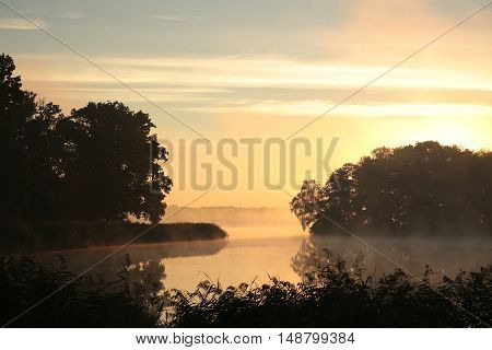 Sunrise over the lake. September, Poland.