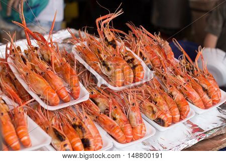 Grilled shrimp in foam box. Grilled big river prawn on foam box for sell in bangkok market.