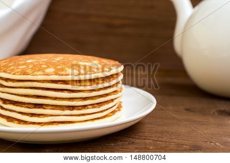Stack of tasty pancakes on the plate for breakfast