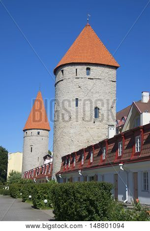TALLINN, ESTONIA - AUGUST 01, 2015: Ancient medieval tower among the townhouses. Historical landmark of the city Tallinn, Estonia