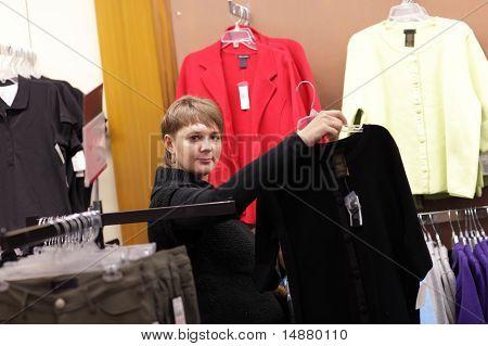 Woman Shows Black Jacket