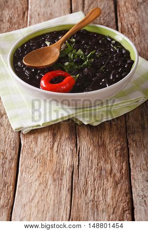 Stewed Black Beans With Spices And Herbs In A Bowl Close-up. Vertical