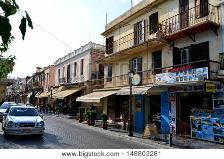 RETHYMNO GREECE - 08.04.2016: city street with people editorial