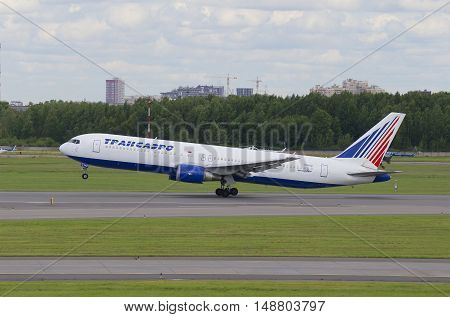 SAINT PETERSBURG, RUSSIA - JULY 24, 2015: Flying the Boeing 767-300ER (EI-RUZ) of the company Transaero. Pulkovo Airport