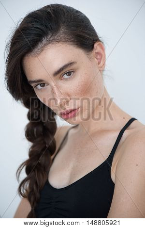skin and hair care concept, portrait of a young freckled woman