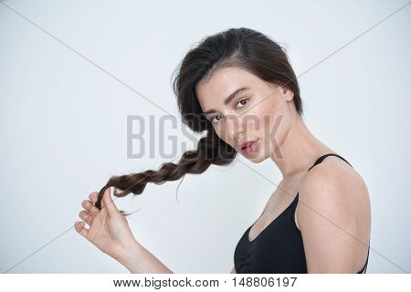 hair care concept, close up of a young girl with pigtail in her hands