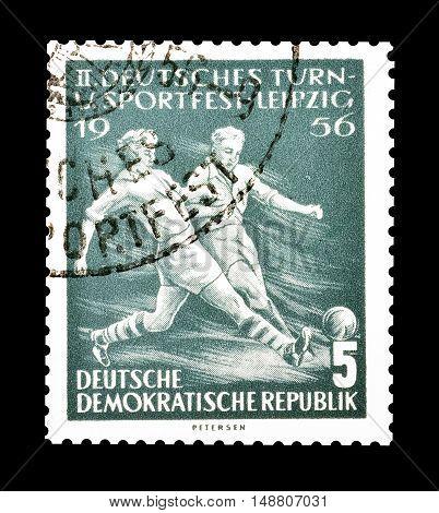 GERMAN DEMOCRATIC REPUBLIC - CIRCA 1957 : Cancelled postage stamp printed by German Democratic Republic, that shows football.