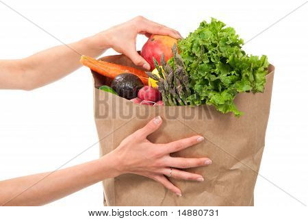 Hands Holding A Shopping Paper Bag Full Of Groceries
