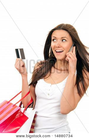 Woman Shopping Bags And Credit  Card Talking On Phone
