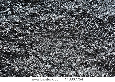 Crumpled wrinkled silver small foil aluminum texture