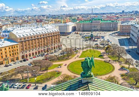 The rooftop of St Isaac's Cathedral is the best place to enjoy the ensemble of St Isaac's Square with green park monument of Tsar Nicholas I Mariinsky Palace historic hotels and mansions St Petersburg Russia.
