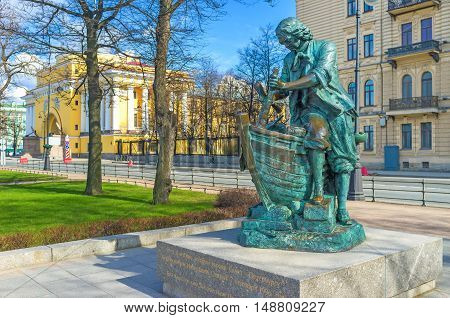 The Tsar Carpenter statue depicts young Peter the Great creating the wooden ship located at Admiralty embankment St Petersburg Russia.