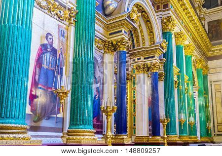 SAINT PETERSBURG RUSSIA - APRIL 25 2015: The green malachite and blue lazurite columns decorate iconostasis of St Isaac's Cathedral on April 25 in Saint Petersburg.