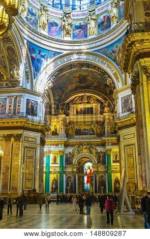 SAINT PETERSBURG RUSSIA - APRIL 25 2015: The rich interior of St Isaac's Cathedral one of the most impressive landmarks of the Russian Imperial capital on April 25 in Saint Petersburg.