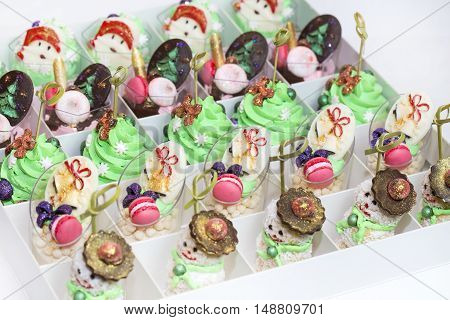 Christmas dessert canapes with cream and chocolate on a white background