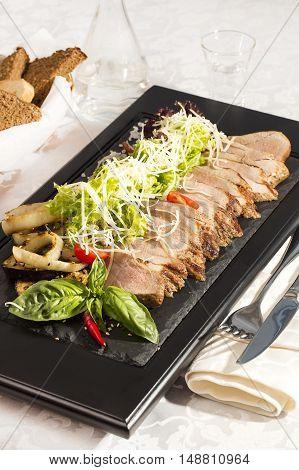 plate of meat and vegetables Steak Studio Tasty