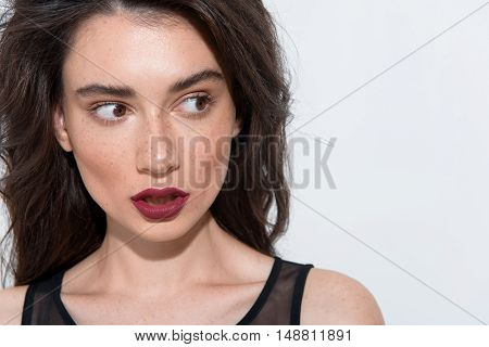 beautiful curious woman looking right at copy space