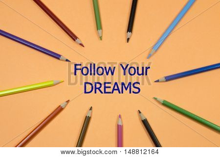 Colored Pen written showing to center with a word follow your dreams