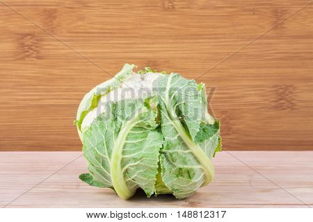 Ripe Cauliflower On Wood Shelf