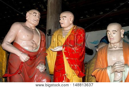 Shi Fang China - June 23 2007: Buddha figures in the South Arbat Hall of the historic Luo Han Temple dating to 650 A. D.