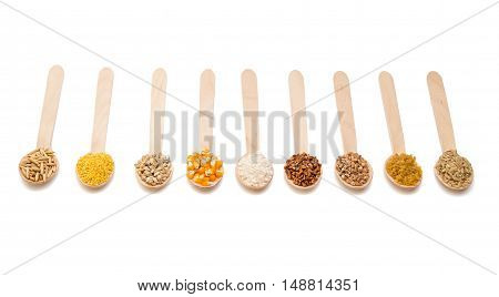 set of wooden spoons with cereals isolated on a white background