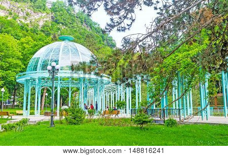 The green shady park in Borjomi gorge boasts the unique hot water source the proud of Borjomi resort Georgia.