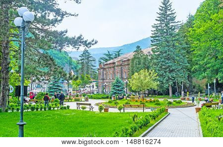 BORJOMI GEORGIA - MAY 26 2016: The pleasent Mineral Water Park with narrow pathes flower beds lush greenery and famous hot water source on May 26 in Borjomi.