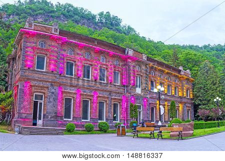 The brightly illuminated mansion in Mineral Water Park of Borjomi Georgia.