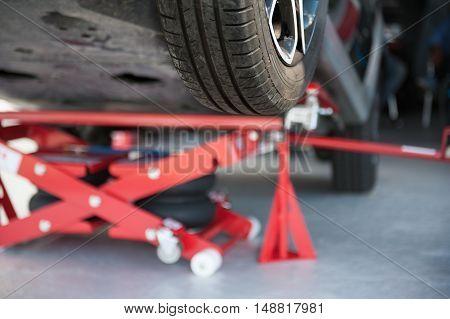 Wheel Detail Of Lift Car In Workshop