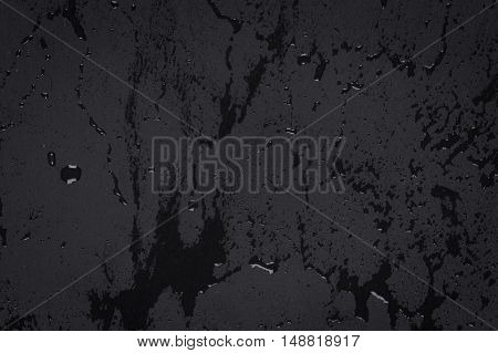 Water Drops On Dark Stone Surface