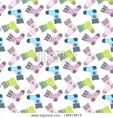 Seamless pattern with colorful socks on the white background.