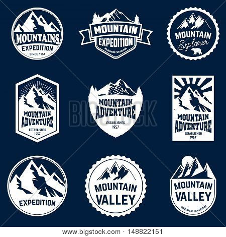 Set of mountains hiking and outdoor adventures emblems.