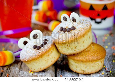 Halloween funny monster muffins with chocolate eyes for treat kids on holiday selective focus