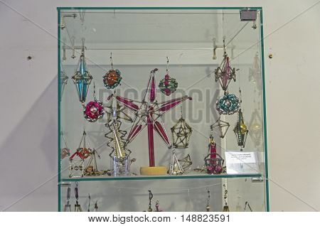 KLIN RUSSIA - JANUARY 16 2016: Museum of Christmas toys. Old Soviet decorations made in mount technology (small glass parts on the wire).
