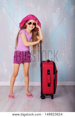 Little lady gathered in travel. The concept of travel and lifestyle.