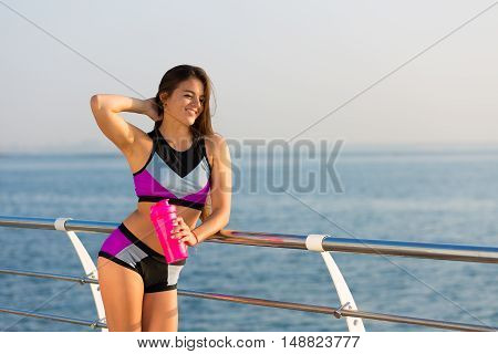 Woman Working Out At The Seaside